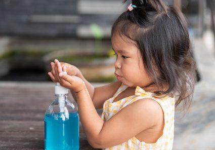 Child Hands Using Wash Hand Sanitizer Gel Pump Dispenser, Selected Focus